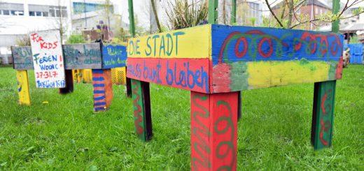 Ab dem kommenden Frühjahr soll es auf dem Lucie-Flechtmann-Platz Rasenfläche und Mutterboden geben. Die Arbeiten beginnen bereits im Herbst. Fotomontage: Schlie