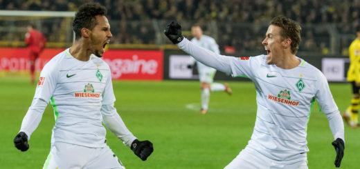 Werders Theo Gebre Selassie (links) und Max Kruse freuen sich über den Sieg in Dortmund. Foto: Nordphoto