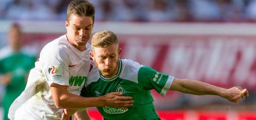 Zweikampf zwischen Florian Kainz (rechts und Augsburgs Raphael Framberger. Foto: Nordphoto